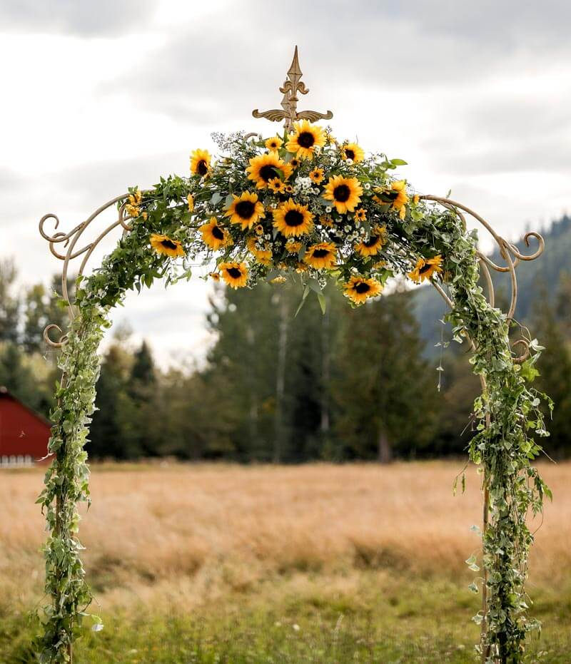 Ceremony arbor with Sunflowers at Mount Peak Farm