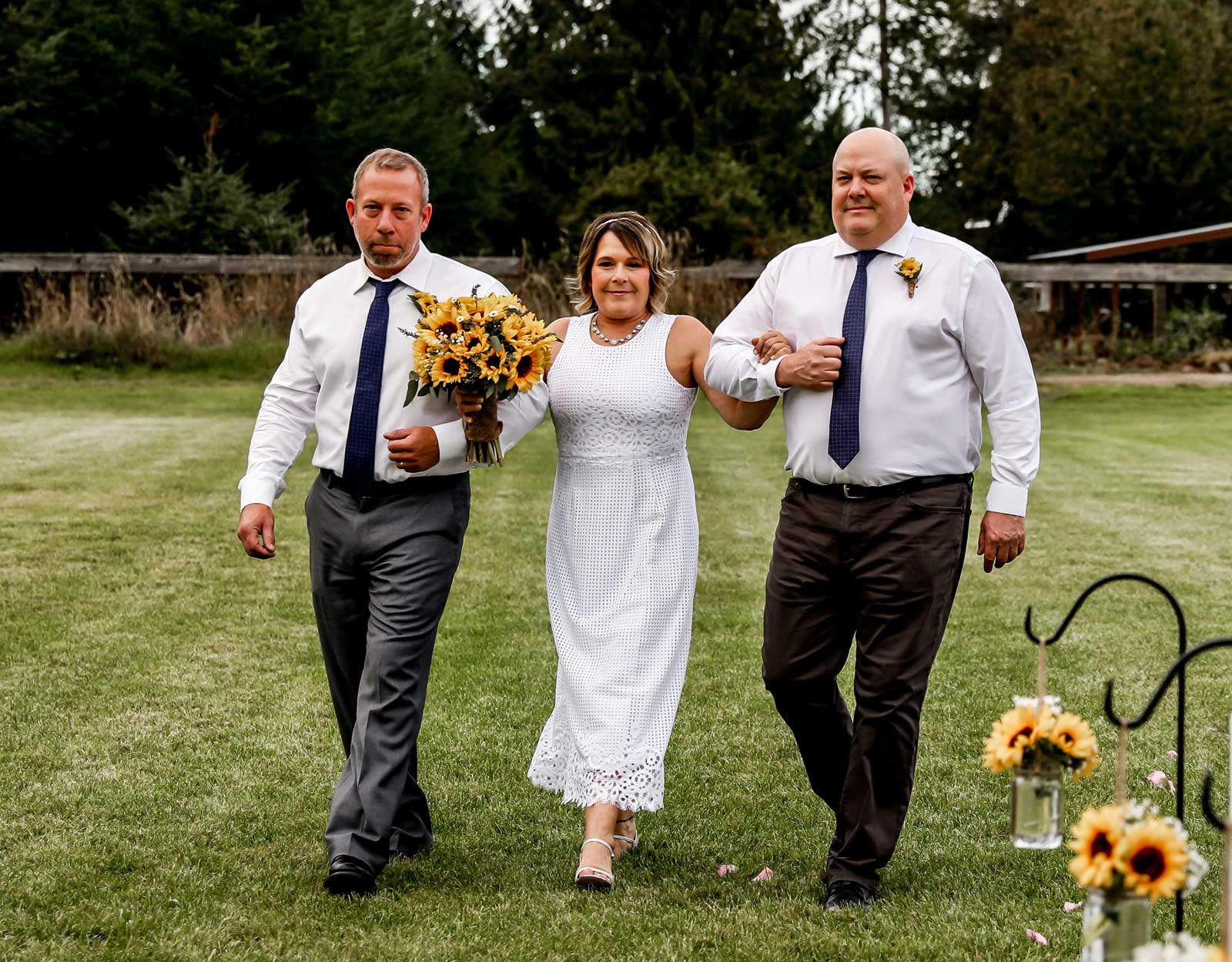Bride and her brothers with sunflower bouquet