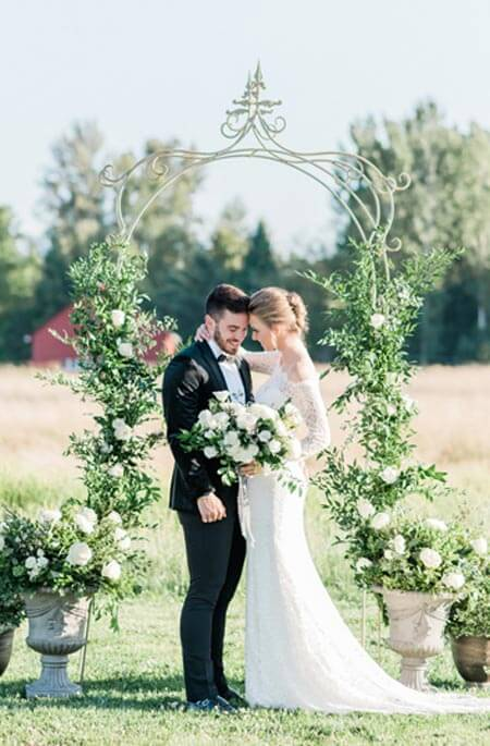 Bride and groom with arbor at Mount Peak Farm