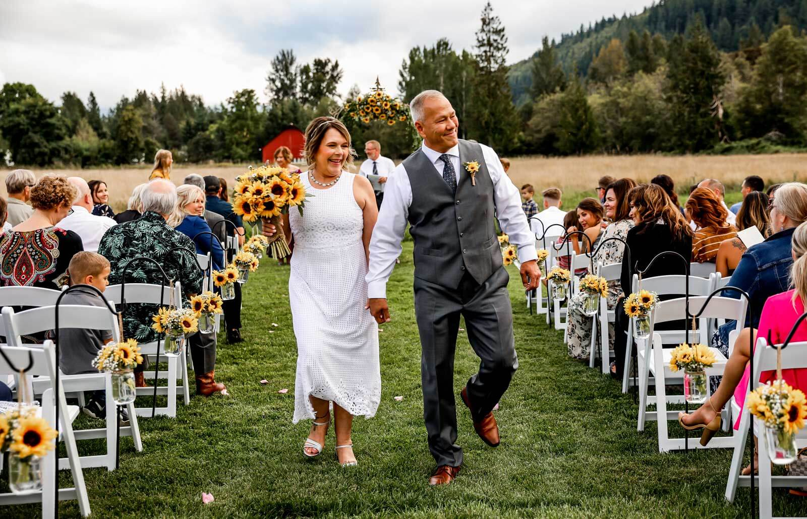 Bride and groom recessional at sunflower wedding at Mount Peak Farm