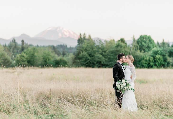 French Countryside Wedding Inspiration Bride and Groom kissing in hayfield