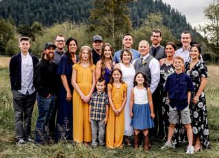 Family portrait at sunflower wedding at Mount Peak Farm