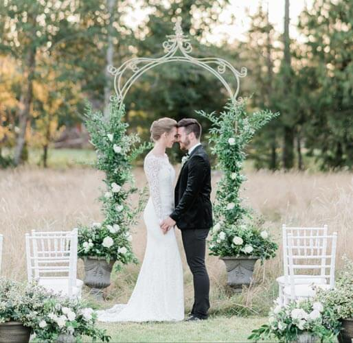 French Countryside Wedding Inspiration Vintage Arbor with bride and groom