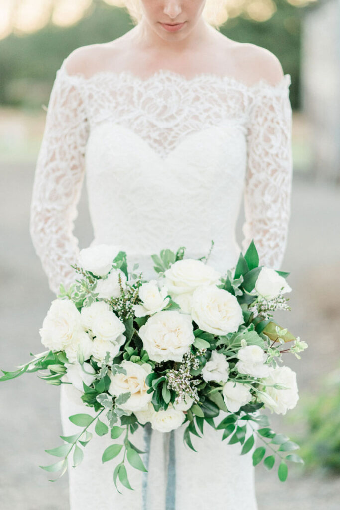 French Countryside Wedding Inspiration Bride holding bouquet