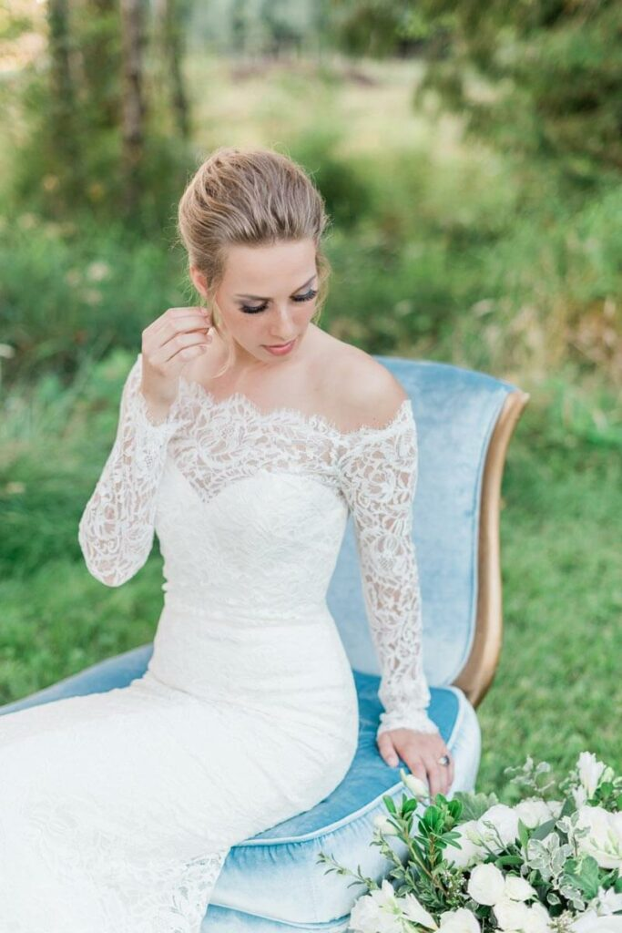 French Countryside Wedding Inspiration bride on vintage velvet chair