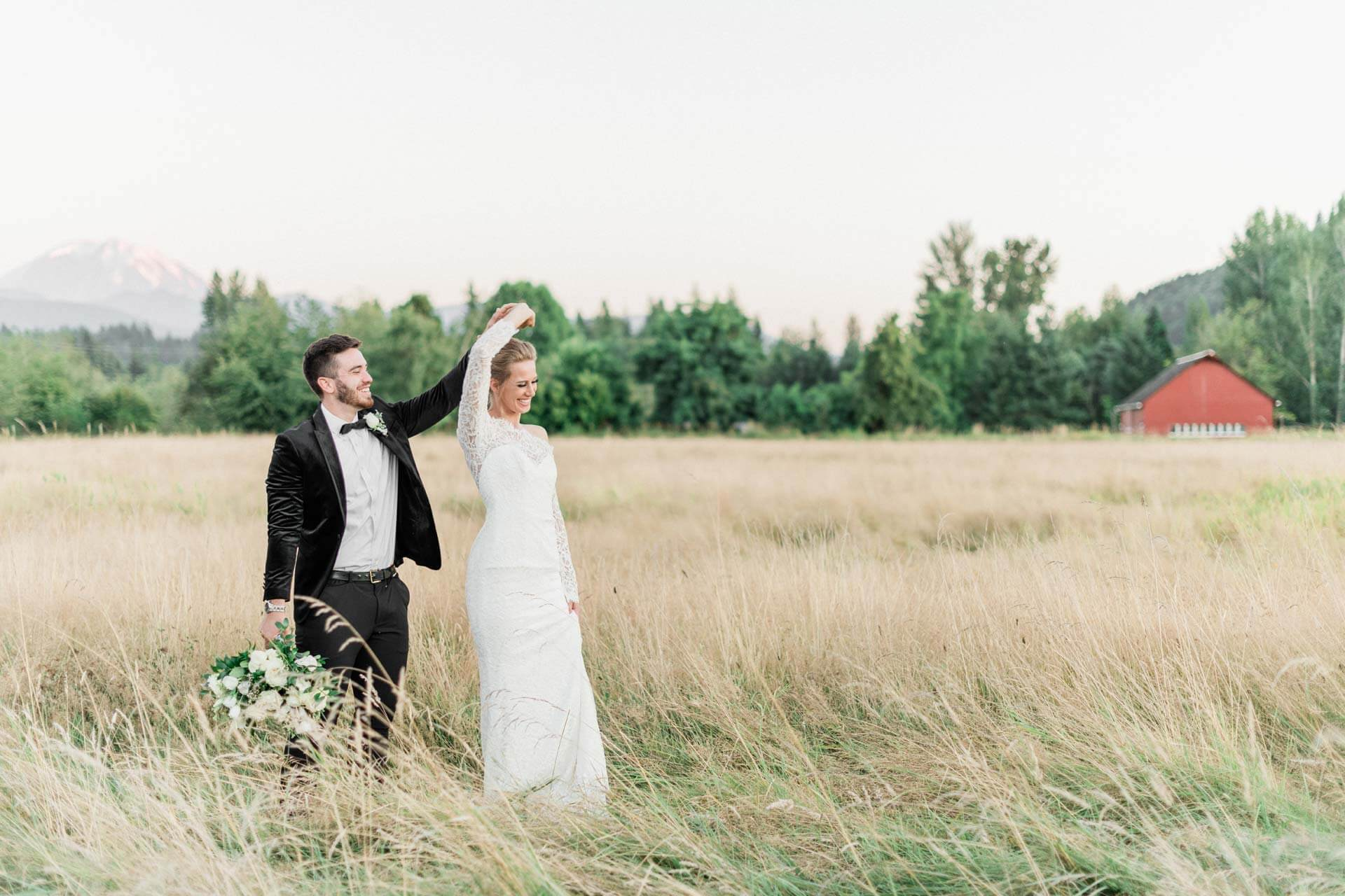 French Countryside Wedding Inspiration Bride and Groom dancing in hayfield