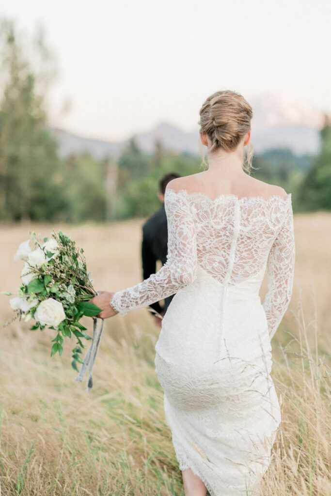 French Countryside Wedding Inspiration back of bride walking in field