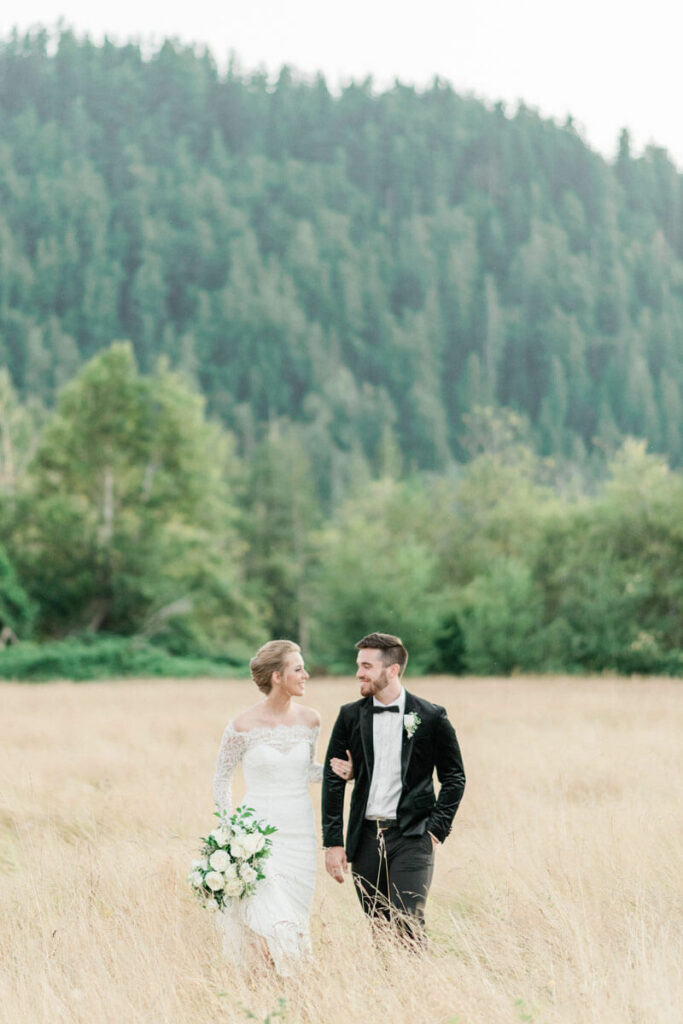 French Countryside Wedding Inspiration Bride and Groom walking in hayfield