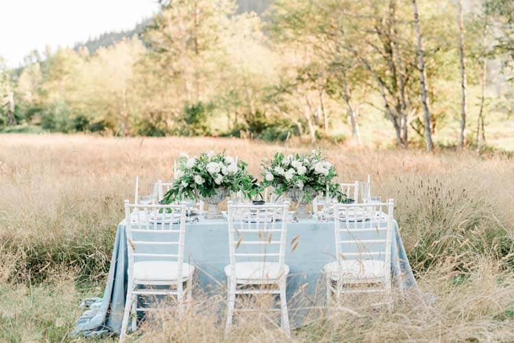 French Countryside Wedding Inspiration reception table in field