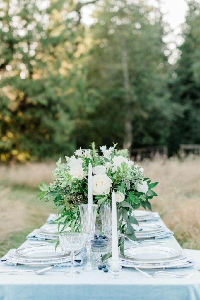 French Countryside Wedding Inspiration reception table in field with trees