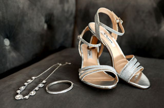 Wedding shoes and jewelry in bridal cottage
