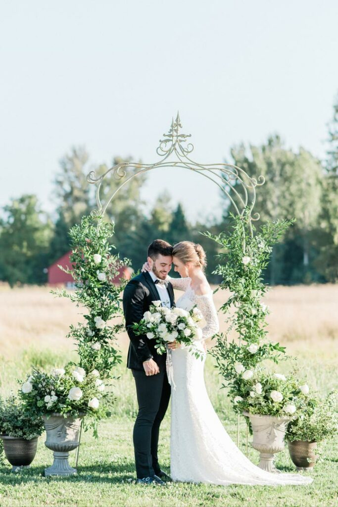 Bride and Groom under arbor at Mount Peak Farm