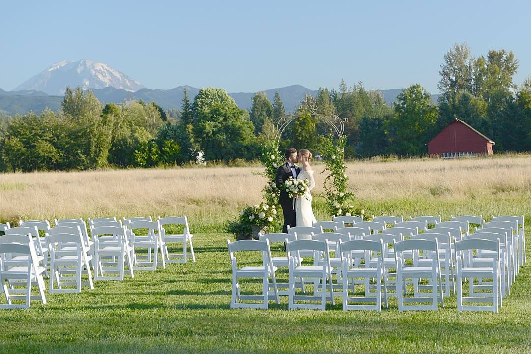 Bride and groom at arbor ceremony at Mount Peak Farm