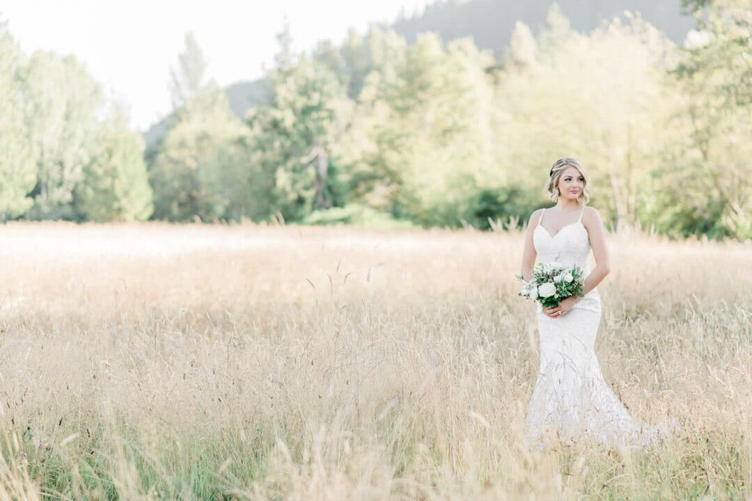 Bride with bouquet in field at Mount Peak Farm
