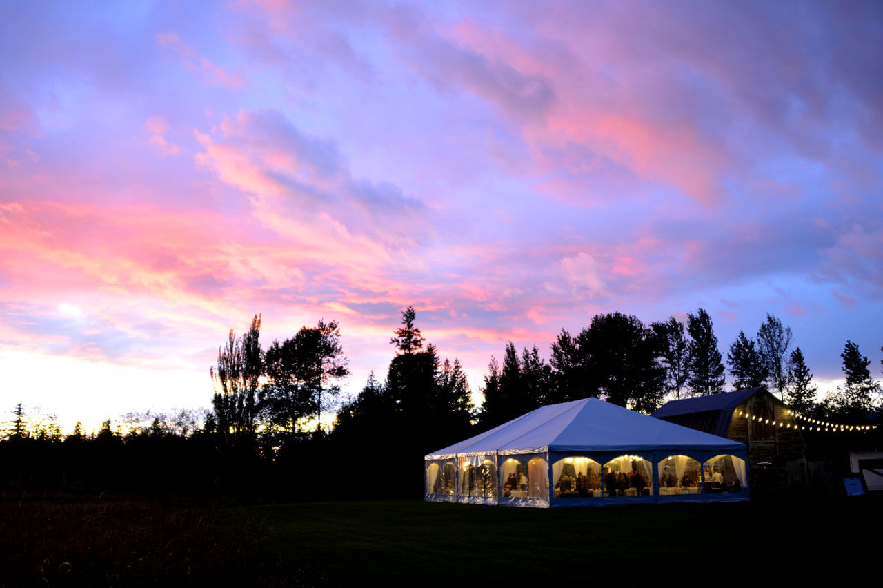 Sunset at Mount Peak Farm over reception tent and barn