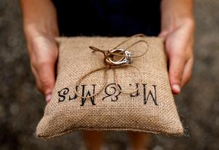 Wedding rings on burlap pillow