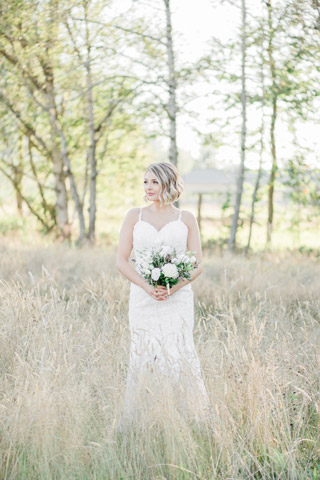 Romantic blush wedding bride in field at Mount Peak Farm