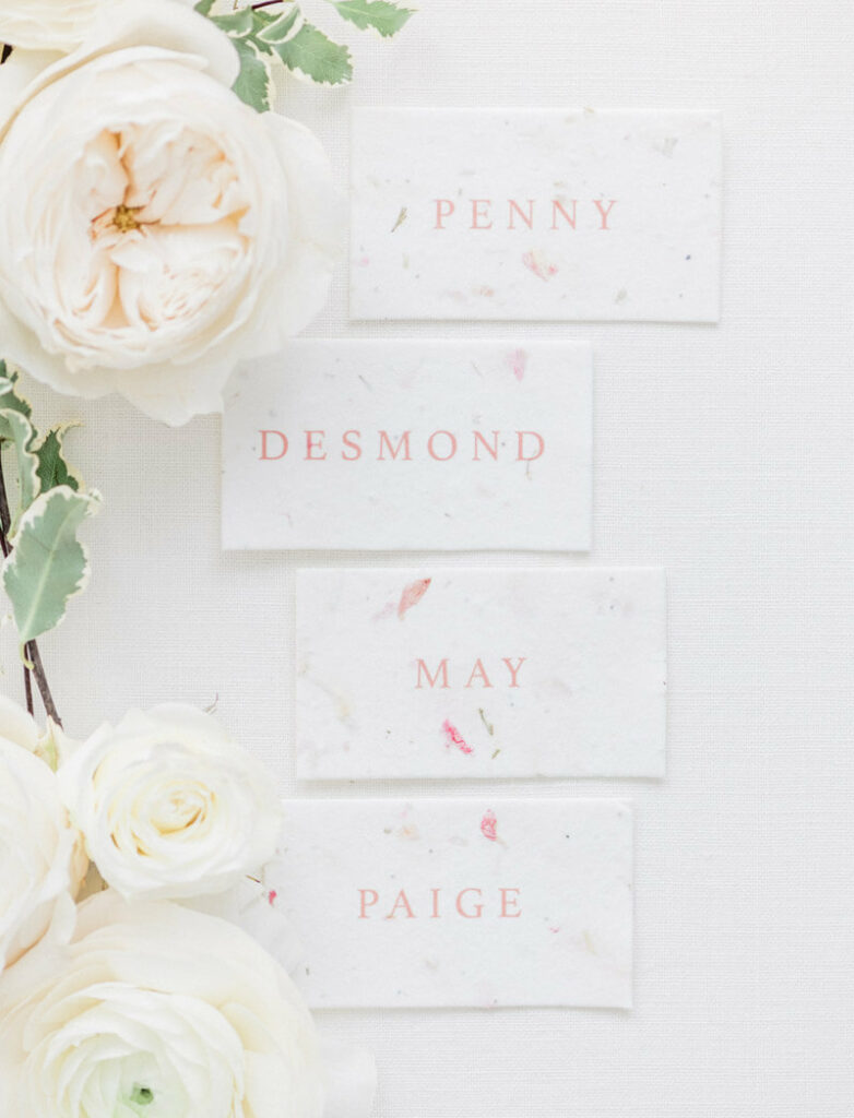 Romantic blush wedding place cards with flowers