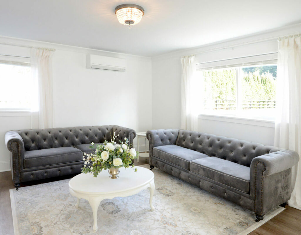 Gray velvet sofas in bridal cottage at Mount Peak Farm