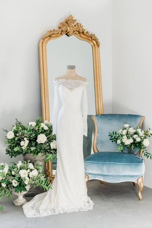 French Countryside Wedding Inspiration gown with gold mirror