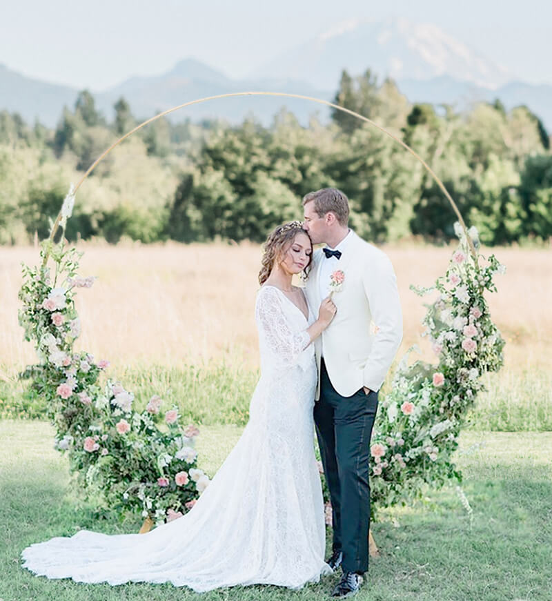 Gold circle arbor with bride and groom Mt Rainier