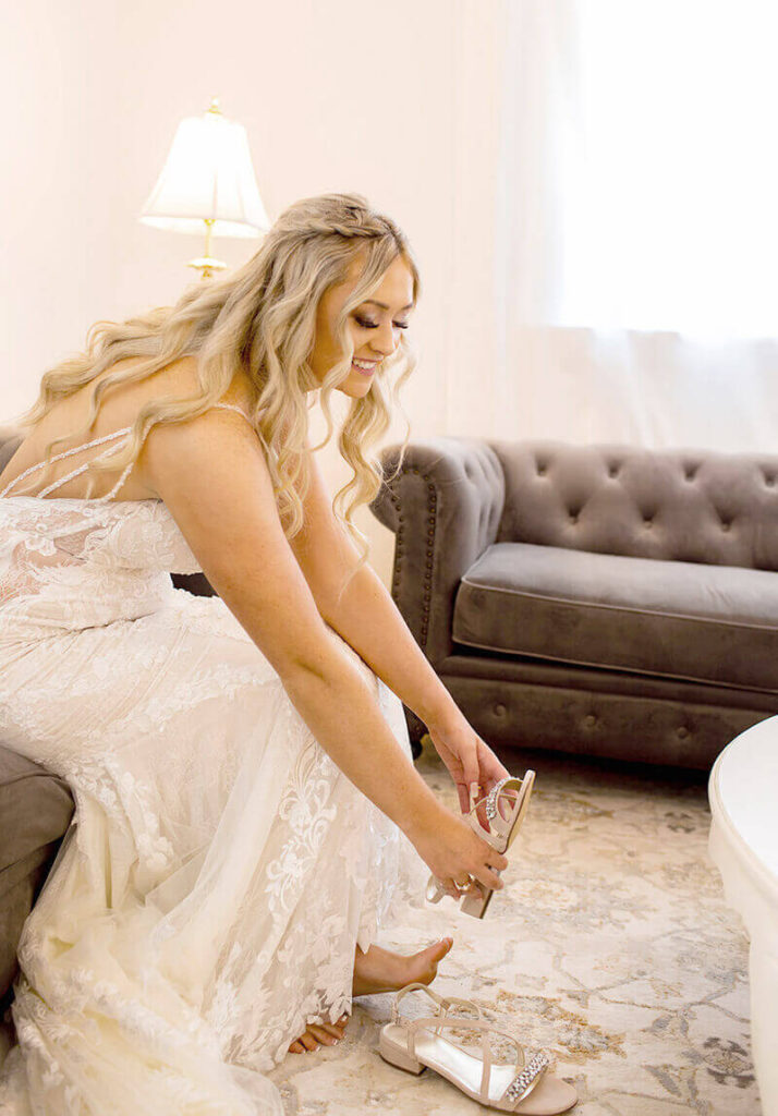 Bride putting on sandals in bridal cottage Mount Peak Farm