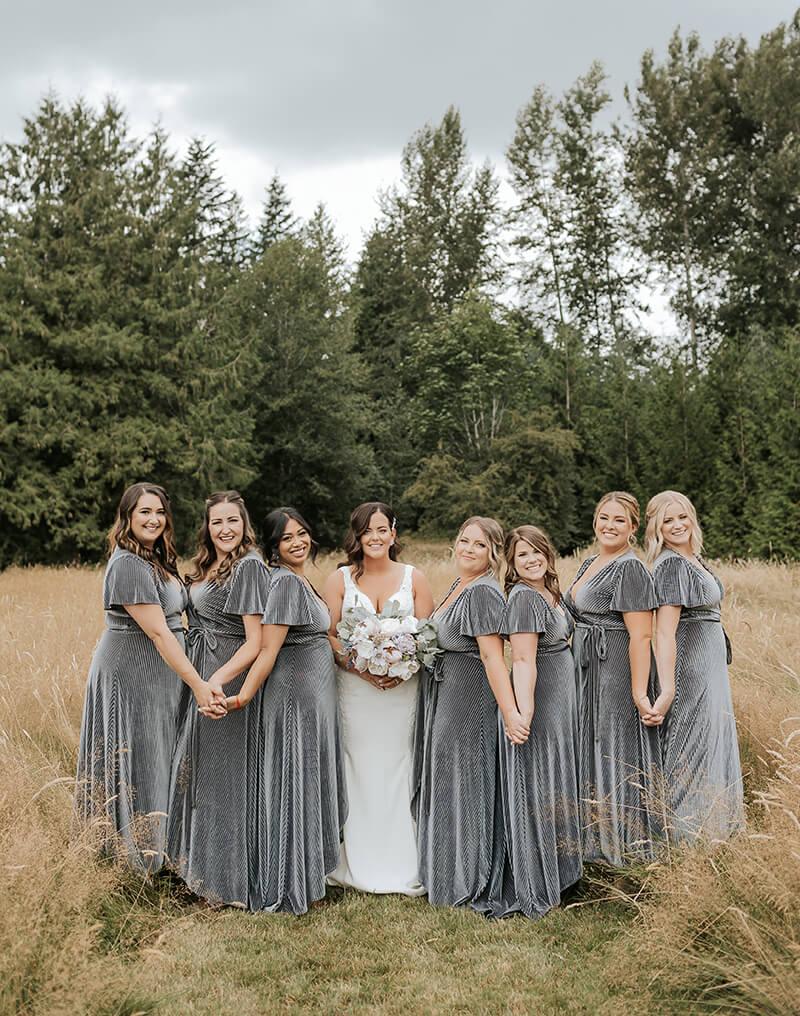 Bridesmaids in hayfield at Mount Peak Farm