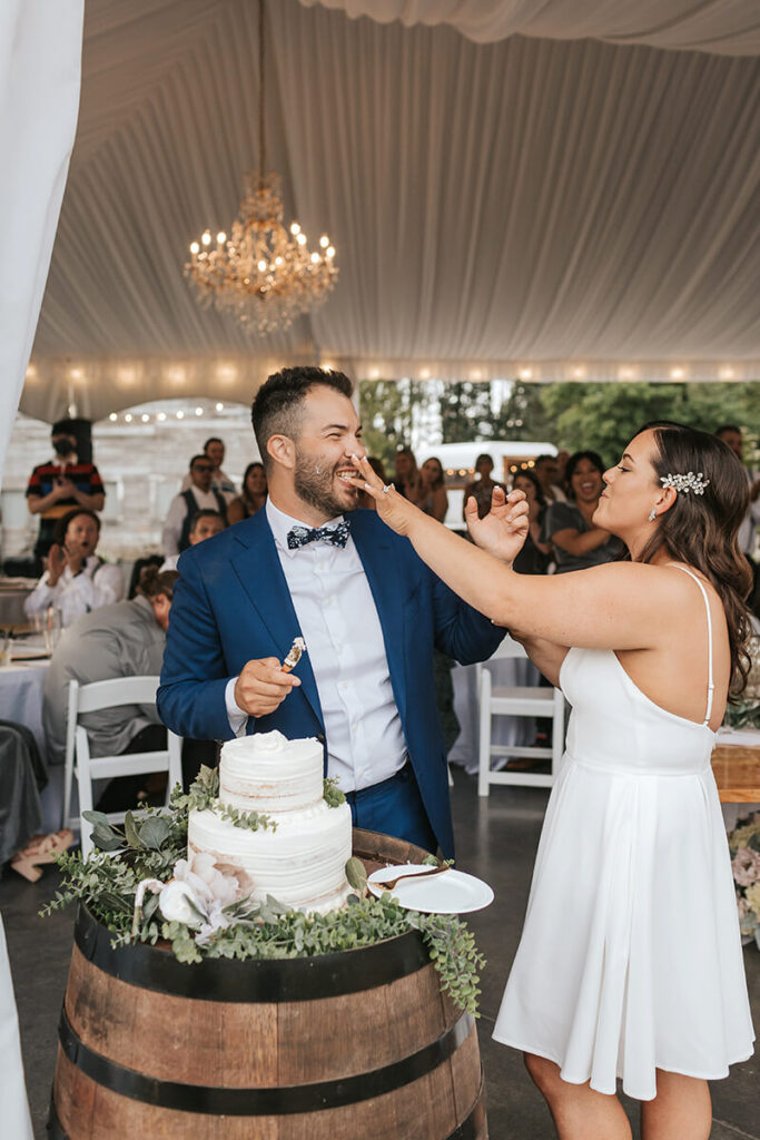 Bride and Groom smashing cake at Mount Peak Farm