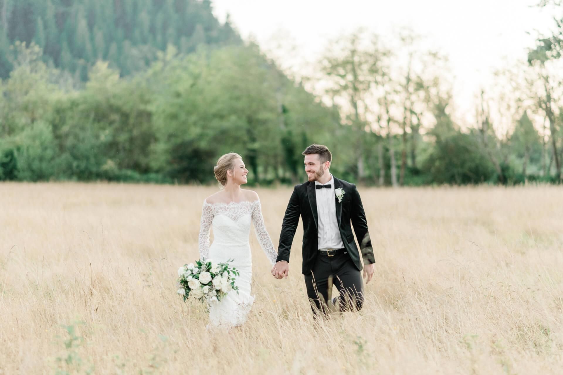 Couple in hayfield at Mount Peak Farm