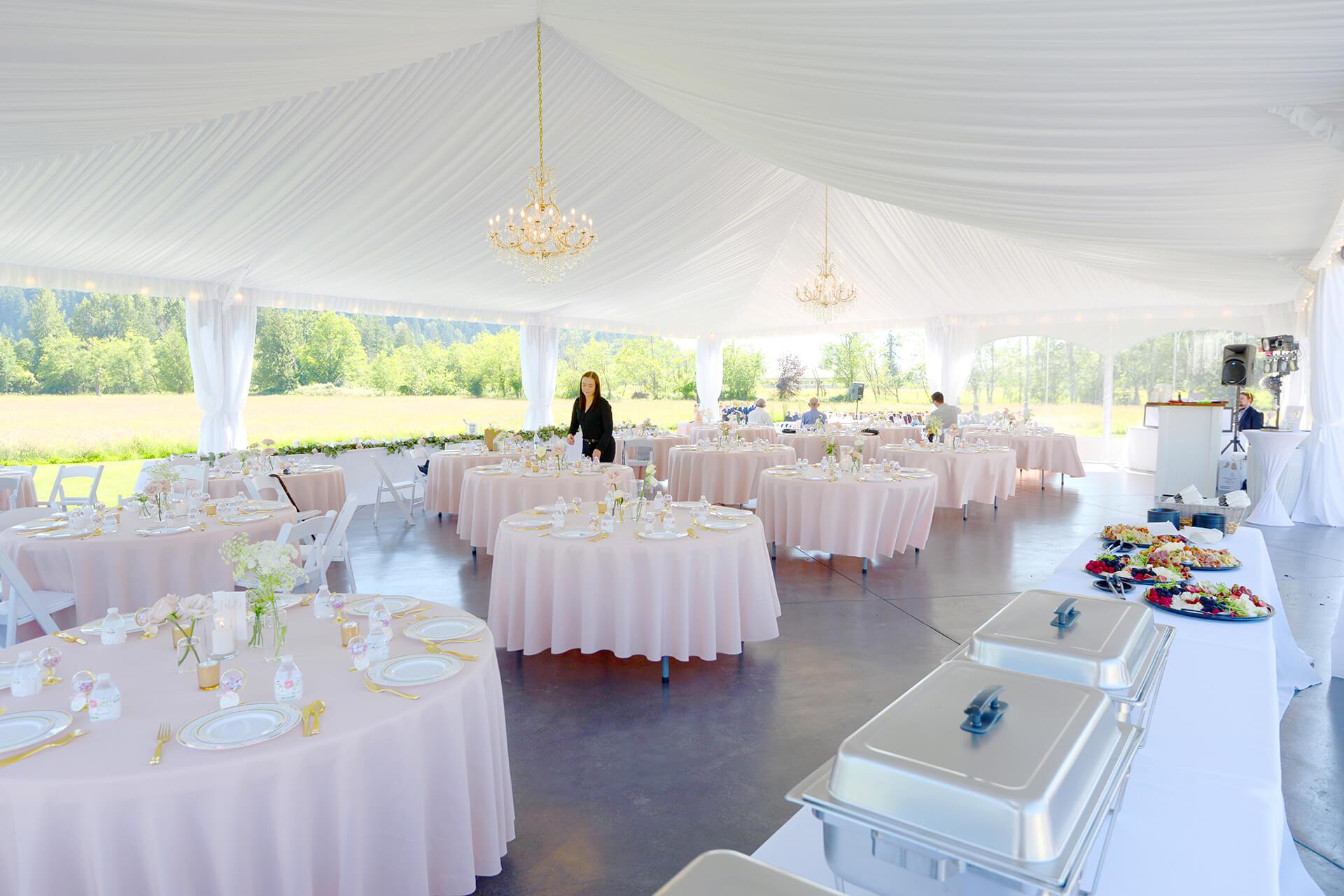 Wedding tables in reception tent at Mount Peak Farm